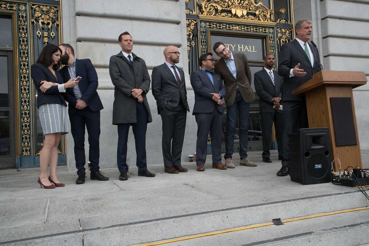 State Senator Scott Wiener speaking to Democratic Party Chair David Campos in back center while Supervisor Jeff Sheehy speaks at the steps of City Hall on Wednesday, Nov. 8, 2017 in San Francisco, CA. Others from left: Supervisor Hilary Ronen, City College Trustee Tom Temprano, Board of Education Member Matt Haney, City College Trustee Rafael Mandelman and Board of Education Member Shamann Walton.