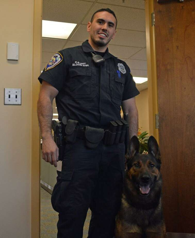 Middletown police Officer Matthew Bloom with his K-9 Koda Photo: Cassandra Day / Hearst Connecticut Media
