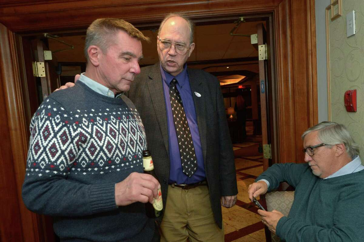 GOP candidate for Andy Conroy gives condolences to Richard Bonenfant at the Norwalk Inn Tuesday, November 8, 2017, in Norwalk, Conn.