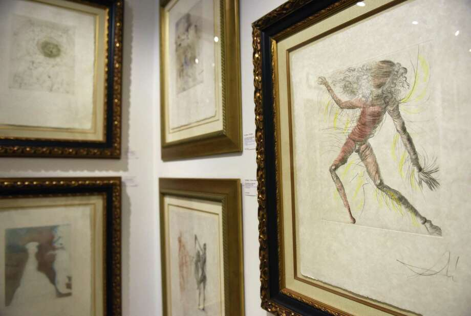"Salvador Dali's ""Cosmonaut,"" right, is displayed with other work from the Hippies Collection at the Dali exhibition at C. Parker Gallery in Greenwich, Conn. Wednesday, Nov. 8, 2017. Dozens of works, displayed in different unique collections, by the Spanish surrealist are displayed at the gallery through Sunday. Photo: Tyler Sizemore / Hearst Connecticut Media / Greenwich Time"