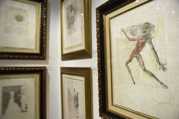 """Salvador Dali's """"Cosmonaut,"""" right, is displayed with other work from the Hippies Collection at the Dali exhibition at C. Parker Gallery in Greenwich, Conn. Wednesday, Nov. 8, 2017. Dozens of works, displayed in different unique collections, by the Spanish surrealist are displayed at the gallery through Sunday."""