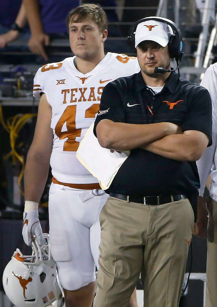 Texas coach Tom Herman and tight end Robert Willis watch from the sideline during a Nov. 4 UT loss at TCU.