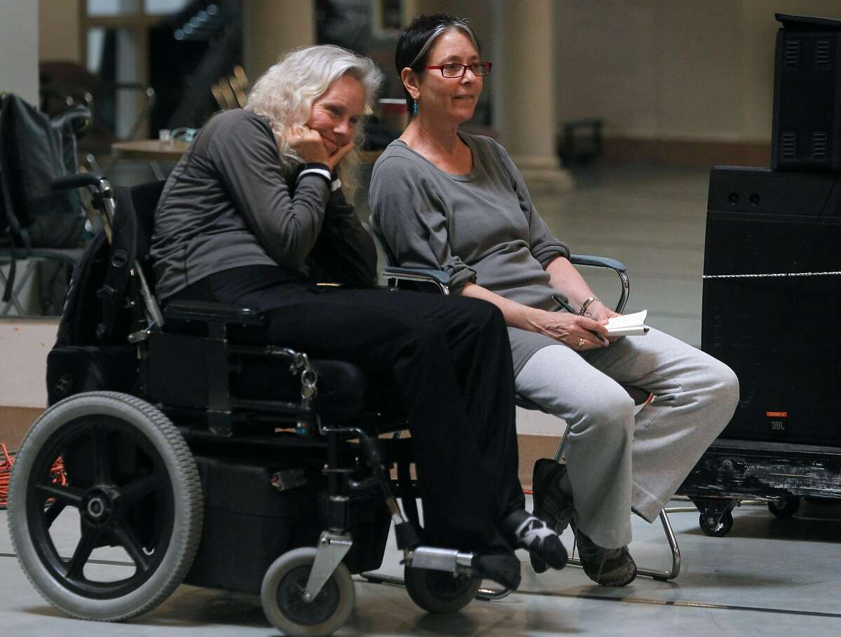 """Axis Dance Company artistic director Judith Smith (left) and choreographer Victoria Marks watch dancers rehearse for the performance of """"What if would you"""" in Oakland, Calif. on Tuesday, March 19, 2013."""