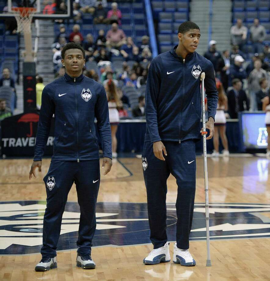 Alterique Gilbert, left, and Terry Larrier will try to get reintegrated into UConn's lineup after missing most of last season with injuries. Photo: File Photo / FR125654 AP