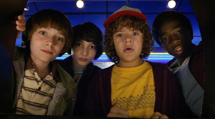 """This image released by Netflix shows Noah Schnapp, from left, Finn Wolfhard, Gaten Matarazzo and Caleb Mclaughlin in a scene from """"Stranger Things,"""" premiering its second season on Friday. (Netflix via AP)"""