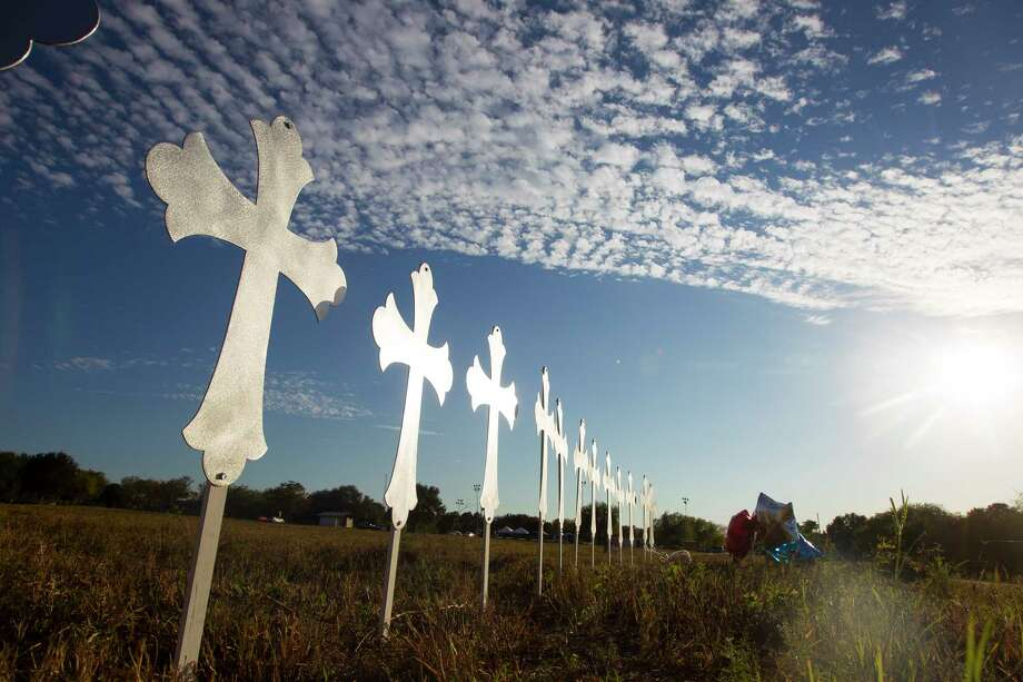 Twenty-six crosses have been placed in a field to honor victims of the church massacre in Sutherland Springs.>>Tributes pour in on social media for victims of Sutherland Springs church massacre... Photo: Mark Mulligan, Houston Chronicle / © 2017 Houston Chronicle