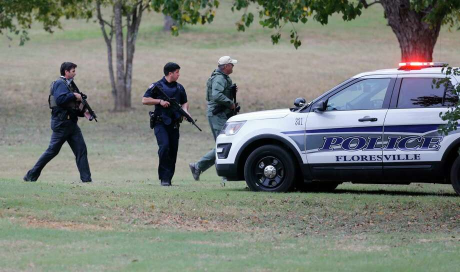 Law enforcement check out a scene near Pecan Park in Floresville, Texas after reports of a man with a revolver who allegedly fired off two rounds. The incident occurred as Vice President Mike Pence was scheduled to make remarks at Floresville High School to pay respects to victims and survivors of Sunday's church shooting at the First Baptist Church in Sutherland Springs, Texas. Police never found the alleged gunman after an extensive sweep of the area. Photo: Kin Man Hui, San Antonio Express-News / ©2017 San Antonio Express-News