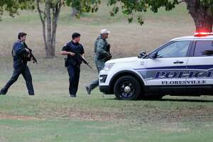Law enforcement check out a scene near Pecan Park in Floresville, Texas after reports of a man with a revolver who allegedly fired off two rounds. The incident occurred as Vice President Mike Pence was scheduled to make remarks at Floresville High School to pay respects to victims and survivors of Sunday's church shooting at the First Baptist Church in Sutherland Springs, Texas. Police never found the alleged gunman after an extensive sweep of the area.