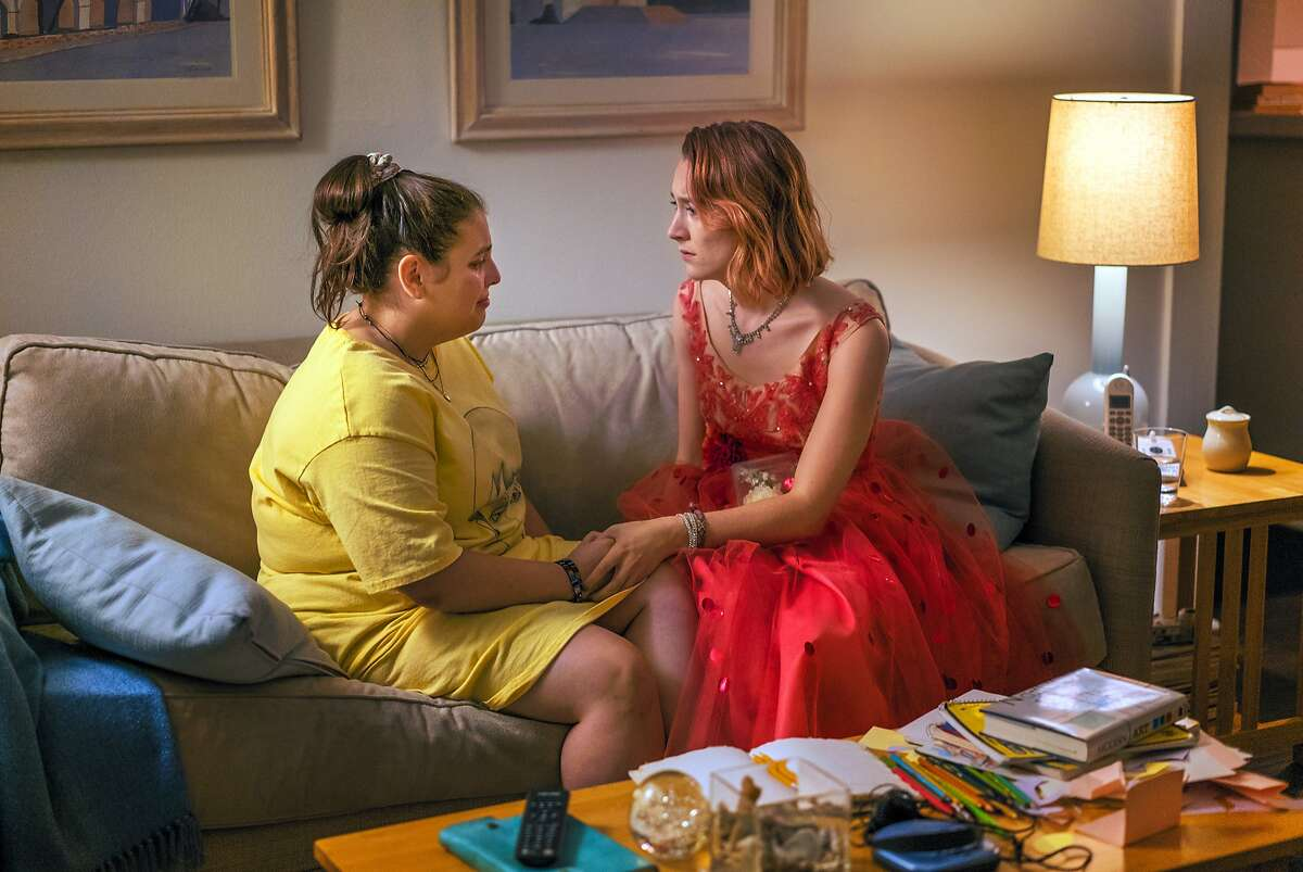 """This image released by A24 Films shows Beanie Feldstein, left, and Saoirse Ronan in a scene from """"Lady Bird."""" (Merie Wallace/A24 via AP)"""