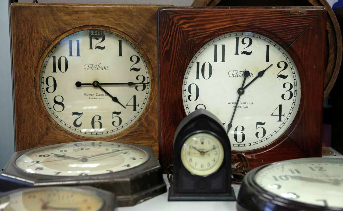 A collection of antique clocks are displayed in the lobby at the Electric Time Company in Medfield, Mass., Thursday, March 10, 2016. (AP Photo/Charles Krupa)