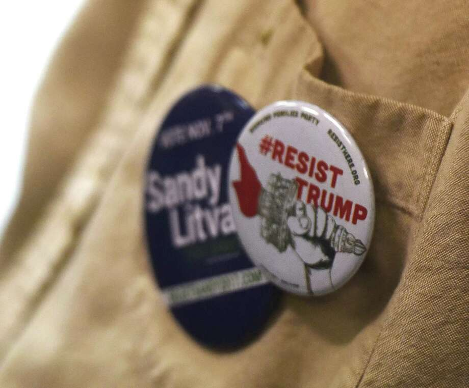 An attendee wears a pin at the Greenwich Democrats Election Night Party at the Senior Center in Greenwich, Conn. Tuesday, Nov. 7, 2017. Photo: Tyler Sizemore / Hearst Connecticut Media / Greenwich Time