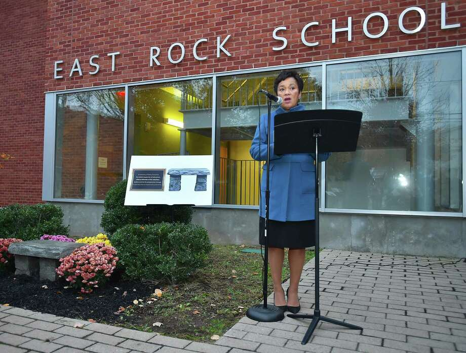 Mayor Toni N. Harp speaks during the dedication of a bench honoring late Board of Education President Daisy Gonzalez Wednesday at East Rock Magnet School in New Haven. Photo: Catherine Avalone / Hearst Connecticut Media / New Haven Register