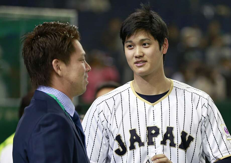 FILE - In this Nov. 10, 2016, file photo, Japan pitcher Shohei Otani, right, chats with Los Angeles Dodgers pitcher Kenta Maeda prior to an international exhibition series baseball game against Mexico at Tokyo Dome in Tokyo. With Otani considering a jump to a Major League Baseball team, Commissioner Rob Manfred said he believes it will be hard for teams to circumvent existing contract rules in pursuit of the coveted two-way player. (AP Photo/Shizuo Kambayashi, File) Photo: Shizuo Kambayashi, AP