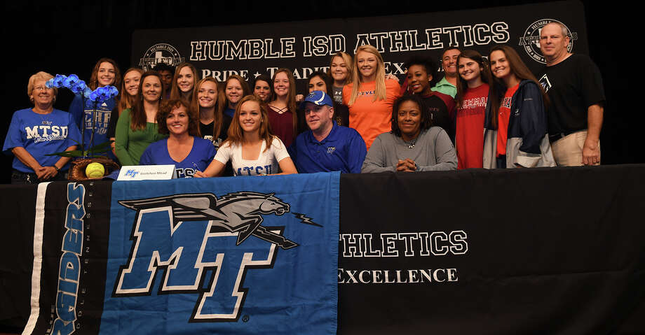 Gretchen Mead, front row center, who plays softball for Kingwood Park High School, signs with Middle Tennessee State University during the Humble ISD Signing Day Ceremony at Charles Bender Performing Arts Center in Humble on Nov. 8, 2017. (Photo by Jerry Baker/Freelance) Photo: Jerry Baker/For The Chronicle