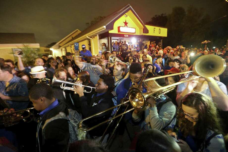 Musicians play outside the former home of music legend Fats Domino, during a second line parade honoring him, in New Orleans, Nov. 1. The thousand-strong group marched and danced from Vaughn's Lounge to Domino's former home in the Lower 9th Ward. Domino, a New Orleans native, died in October Photo: Gerald Herbert /Associated Press / Copyright 2017 The Associated Press. All rights reserved.