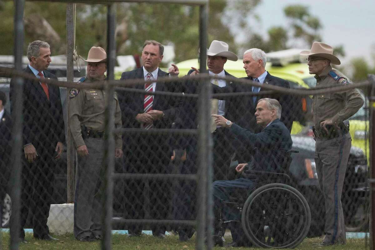 U.S. Vice President Mike Pence and Texas Governor Greg Abbott meet with law enforcement leadership like Texas DPS Director Steven McCraw, right, and FBI Special Agent in Charge Chris Combs during a visit to the First Baptist Church in Sutherland Springs where on Sunday, Nov. 5 26 people were killed by a gunman. Wednesday, Nov. 8, 2017, in Sutherland Springs.