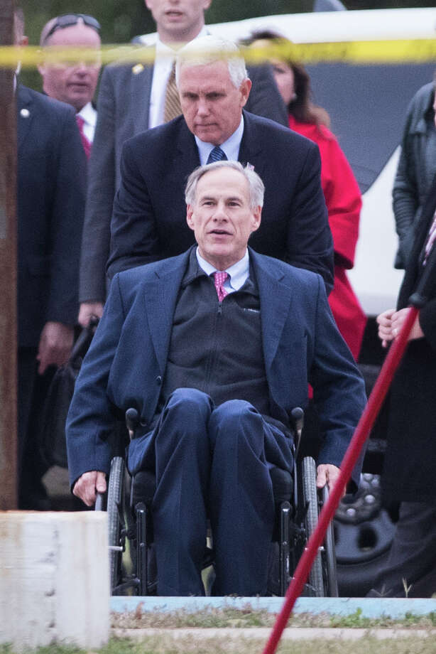 Vice President Mike Pence helps Texas Governor Greg Abbott go up a ramp during their visit to the Sutherland Springs days after the fatal shooting Nov. 5th which killed 26 people. Wednesday, Nov. 8, 2017, in Sutherland Springs. Photo: Marie D. De Jesus, Houston Chronicle / © 2017 Houston Chronicle