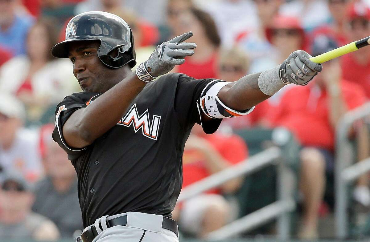 Miami Marlins' Marcell Ozuna bats during the third inning of an exhibition spring training baseball game against the St. Louis Cardinals Thursday, March 3, 2016, in Jupiter, Fla. (AP Photo/Jeff Roberson)