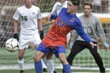 Danbury's Riley Moore (23) was in position to get the ball, on a corner kick, in front of New Milford's Alexander Michalek (9) in the boys State Class LL Soccer game between Danbury and New Milford high schools, Wednesday afternoon at New Milford High School, in New Milford, Conn, November 8, 2017. New Milford goalie Brandon Romero (00) and Sean Murphy (26) watch from the goal.
