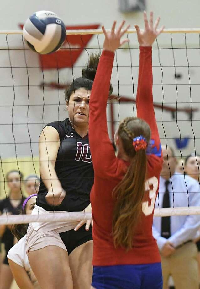 Burnt Hills' Myla Dobson, left, hits the ball past Massena's Ariana Thompson during a Class A regional girls' volleyball match at Broadalbin-Perth High School on Wednesday, Nov. 8, 2017 in Broadalbin, N.Y. (Lori Van Buren / Times Union) Photo: Lori Van Buren, Albany Times Union / 20042084A