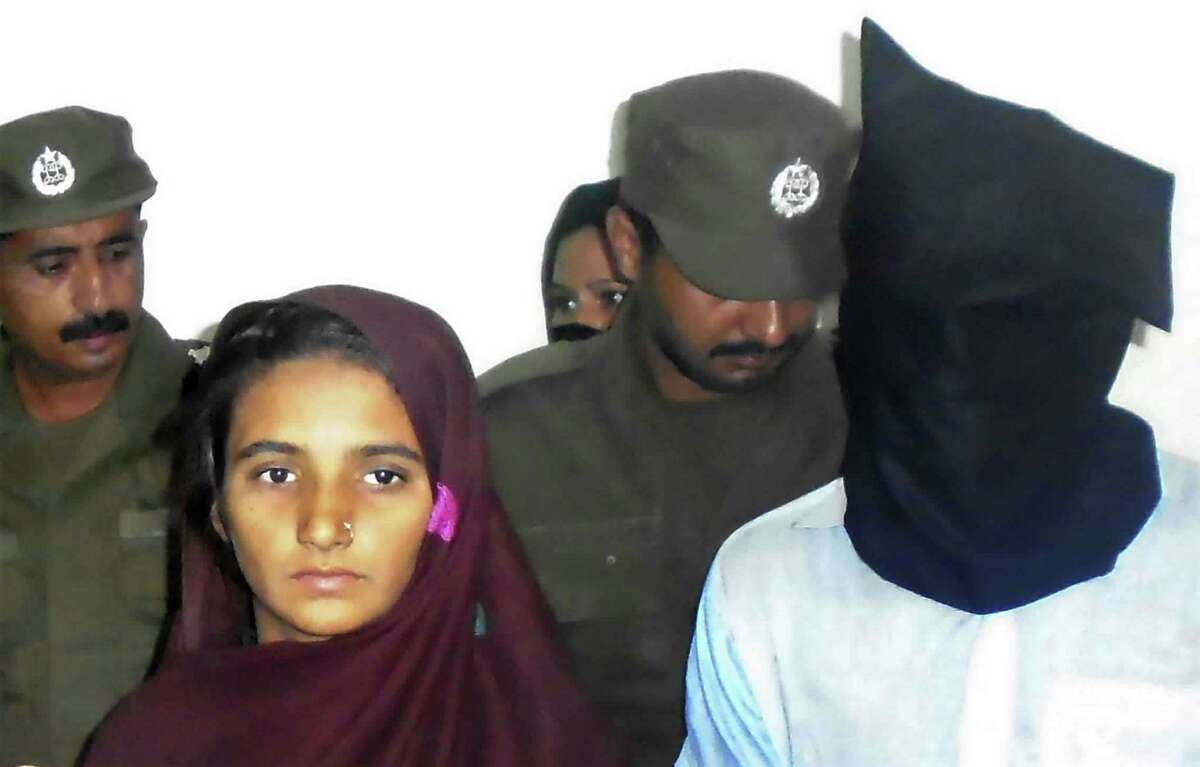Aasia Bibi and her boyfriend, Shahid Lashari , were presented to journalists at a police station in Pakistan on Oct. 30.