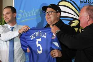 The Sugar Land Skeeters' new manager Pete Incaviglia, center, is introduced by owner Kevin Zlotnik, left, and president Jay Miller during a press conference at the Constellation Field on Wednesday, Nov. 8, 2017, in Sugar Land. Incaviglia is a veteran who played 12 years in Major League Baseball. ( Yi-Chin Lee / Houston Chronicle )