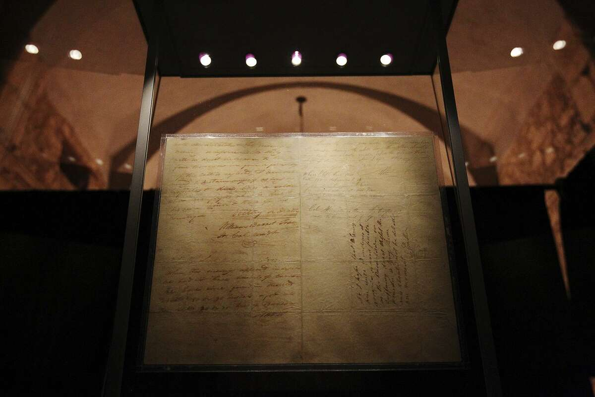"""The original """"victory or death"""" letter written by Alamo commander Lt. Col. William Barret Travis is seen at the Alamo in 2013. The letter was placed on a 13-day display at the Alamo to commemorate the 177th anniversary of the battle and Texas independence."""