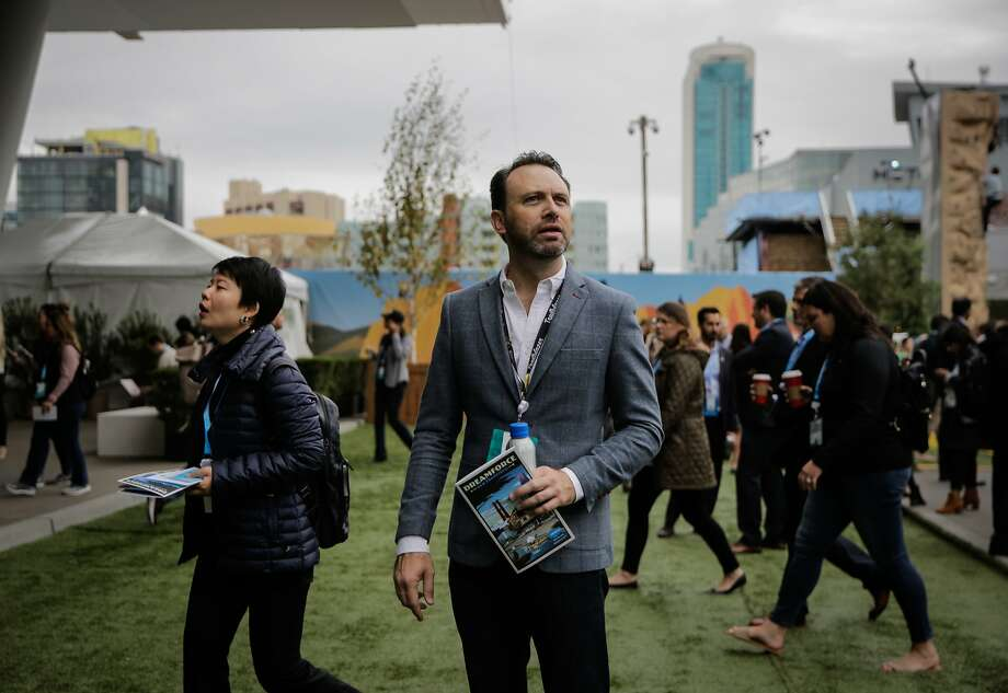 The chair of the Dreamforce event, Michael Peachey (center), pauses for a moment before entering the Moscone center south in San Francisco, Calif., on Wednesday, Nov. 8, 2017. Photo: Gabrielle Lurie / The Chronicle