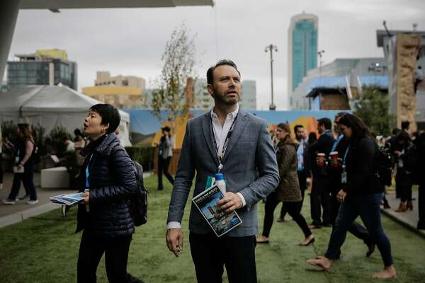 The chair of the dreamforce event Michael Peachey (center) pauses for a moment before entering the Moscone center south in San Francisco, Calif., on Wednesday, Nov. 8, 2017.