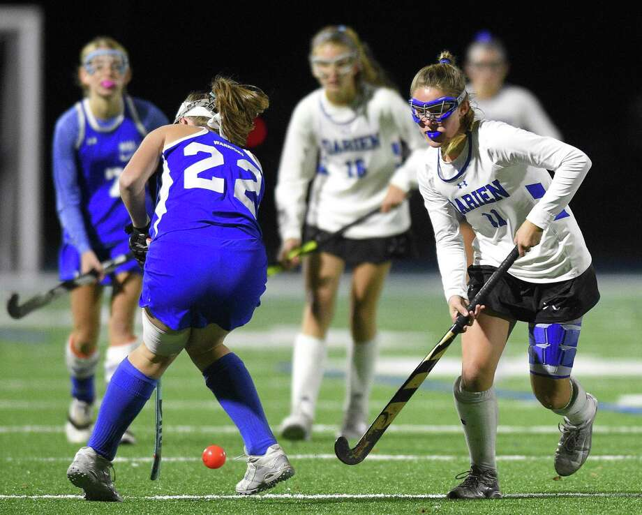 Darien's Kendall Wisinski battles for the ball with Hall's Margaret Grant during the Blue Wave's 6-0 victory Wednesday in the Class L tournament in Darien. Photo: Matthew Brown / Hearst Connecticut Media / Stamford Advocate