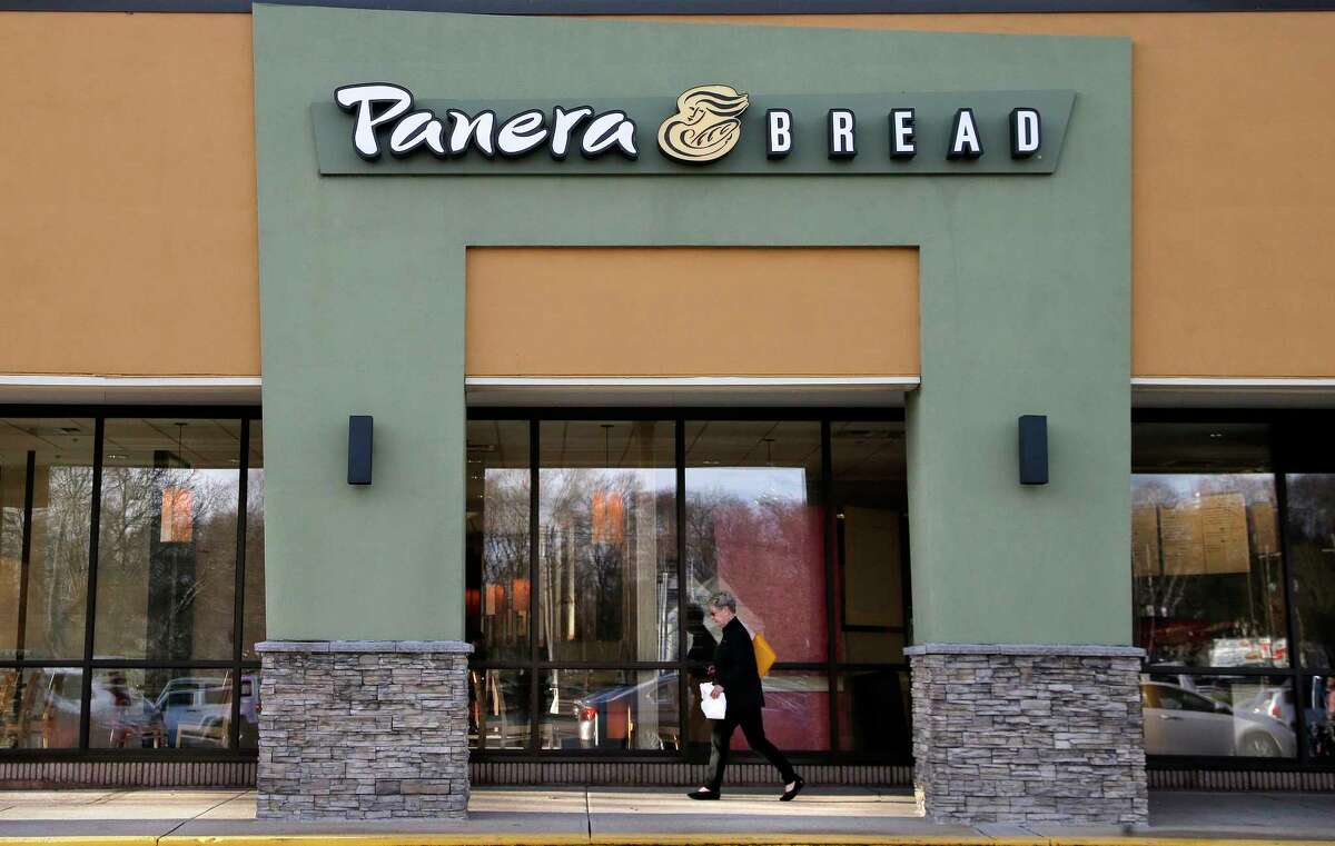 In this Wednesday, April 12, 2017, file photo, a passer-by walks near an entrance to a Panera Bread restaurant in Natick, Mass. Panera is looking at moving its Glenmont location to add a drive-thru.(AP Photo/Steven Senne, File) ORG XMIT: NYBZ339