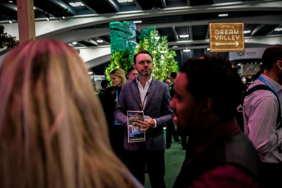 Dreamforce event chair Michael Peachey pauses for a moment while exploring the dreamforce event at Moscone center south in San Francisco, Calif., on Wednesday, Nov. 8, 2017.