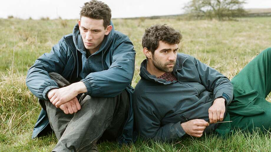 """Emotionally troubled sheep farmer Johnny (Josh O'Connor, left) and migrant worker Gheorghe (Alec Secareanu) in """"God's Own Country."""" Photo: Samuel Goldwyn Films"""