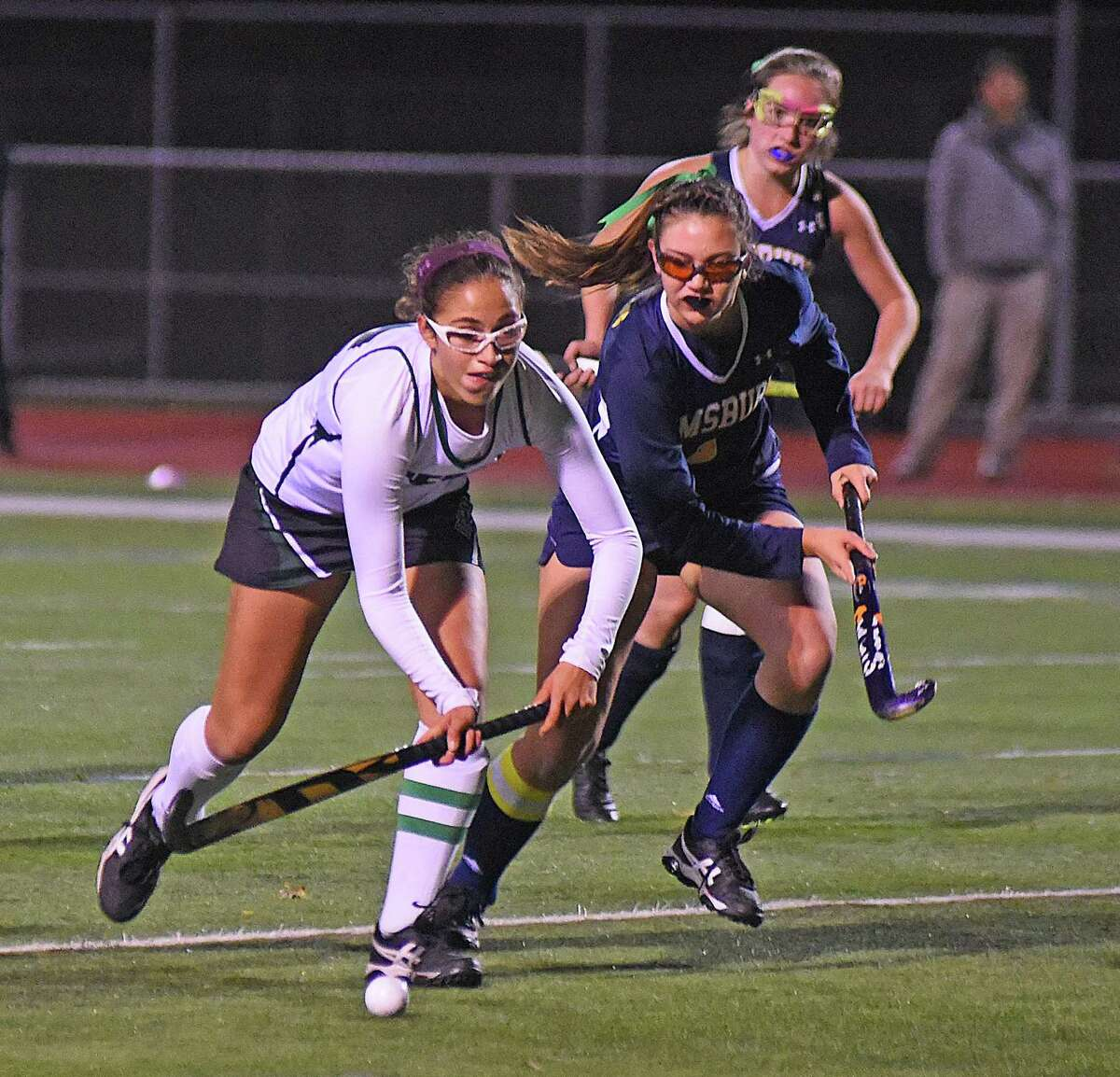 Norwalk's Jacqueline Mirabile, left, pushes the ball up the field ahead of Simsbury defender Devon Murphy.