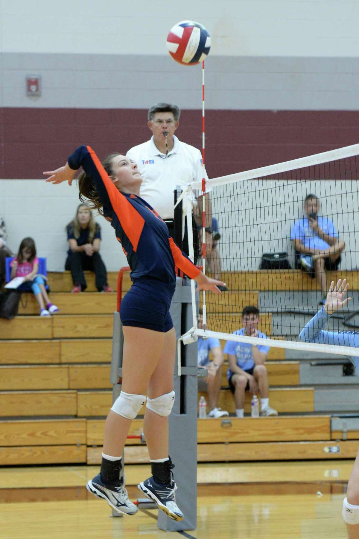 Gabby Collins (11) of Seven Lakes tries for a kill shot in the first set of a high school volleyball game between the Seven Lakes Spartans and the Clements Rangers during the 2017 Cy-Fair ISD/Katy ISD Classic on August 10, 2017 at Cinco Ranch High School, Katy, TX.