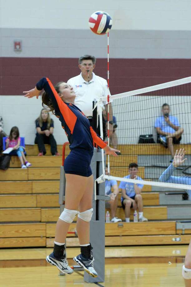 Gabby Collins (11) of Seven Lakes tries for a kill shot in the first set of a high school volleyball game between the Seven Lakes Spartans and the Clements Rangers during the 2017 Cy-Fair ISD/Katy ISD Classic on August 10, 2017 at Cinco Ranch High School, Katy, TX. Photo: Craig Moseley, Staff / ©2017 Houston Chronicle