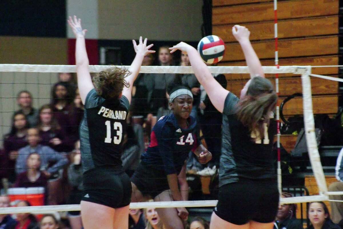 Dawson's Kynnedi Johnson (14) tries to hit a shot past Pearland's Sam Demmon (13) and Pearland's Kaylie Kovach (41) Friday, Oct 13 at Dawson High School.