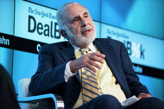 FILE — Carl Icahn speaks during The New York Times' DealBook Conference in New York, Nov. 3, 2015. The billionaire investor announced via Twitter that he will no longer be advising President Donald Trump on regulatory matters. (Karsten Moran/The New York Times)