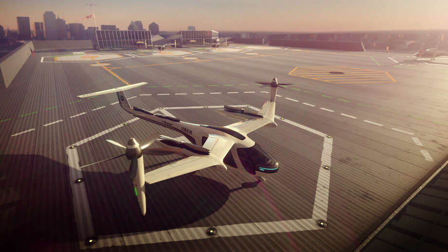 Commuters could get some relief from congested roads if Uber's plans for flying taxis work out. The ride-hailing service has unveiled an artist's impression of the futuristic machine it hopes to use for demonstration flights in 2020 and deploy for ride-sharing by 2028. Photo: HONS / Uber Technologies