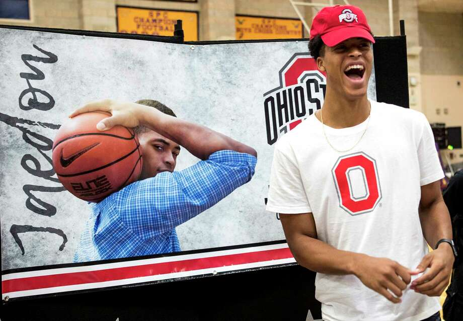 Jaedon LeDee smiles as he gets ready to sign a national letter of intent to play basketball at Ohio State during a signing day ceremony at the Kinkaid School on Wednesday. Photo: Brett Coomer, Staff / © 2017 Houston Chronicle