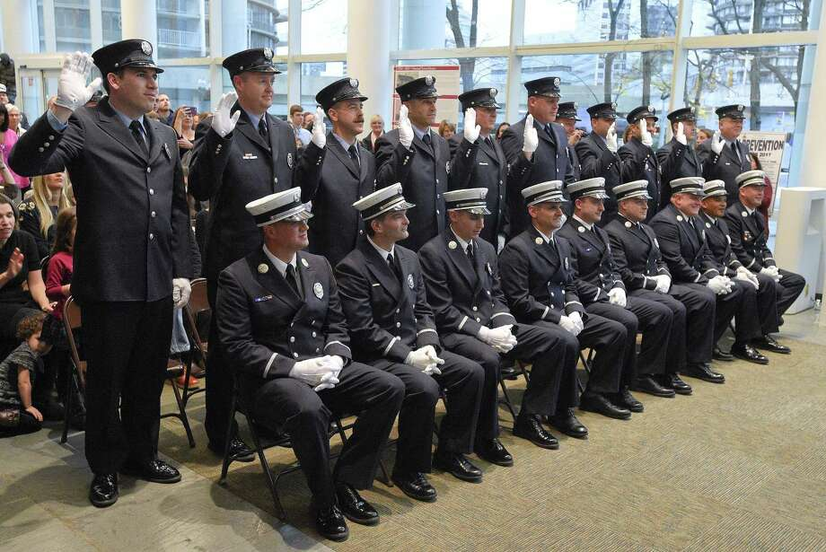 Newly appointed City of Stamford fire officers take an oath administered by Mayor David Martin during a promotion ceremony for the Stamford Fire Department at the Stamford Government Center on Tuesday, Nov. 8, 2017 in Stamford, Connecticut. Photo: Matthew Brown / Hearst Connecticut Media / Stamford Advocate