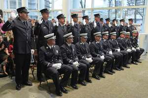 Newly appointed City of Stamford fire officers take an oath administered by Mayor David Martin during a promotion ceremony for the Stamford Fire Department at the Stamford Government Center on Tuesday, Nov. 8, 2017 in Stamford, Connecticut.