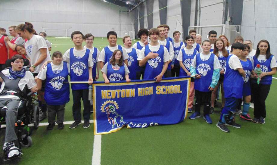 Newtown High School students getting ready for the opening ceremonies at the SWC Unified Soccer Tournament, held at the NYA Sports and Fitness Center in Newtown Nov. 1, 2017. Photo: Photo Courtesy Of NYA Sports & Fitness Center / Photo Courtesy Of NYA Sports & Fitness Center / Copyright 2009
