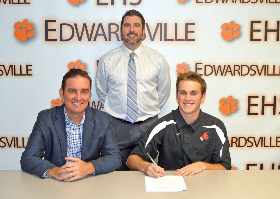 Edwardsville senior Reid Hendrickson committed to play baseball at the University of Central Missouri. In the front row from left to right are father Darin Hendrickson and Reid Hendrickson. EHS coach Tim Funkhouser is standing in the back. Not pictured is mother Laura Hendrickson.