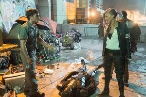 """Josh Hutcherson (left) and Eliza Coupe star in """"Future Man"""" on Hulu."""
