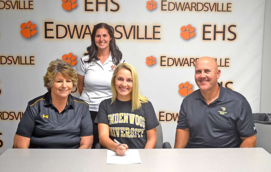 Edwardsvile senior Allie Hosto committed to play field hockey at Lindenwood University. In the front row, from left to right, are mother Melissa Hosto, Allie Hosto and father Richard Hosto. EHS coach Jaimee Phegley is standing in the back.