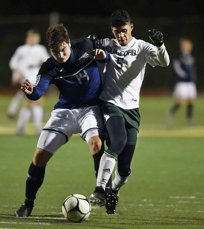 Guilford senior midfielder Justin O'Leary battles Wethersfield junior defenseman Brendon Mansaku in the second round of the Class L boys state soccer tournament, Wednesday, Nov. 8, 2017, at the Kavanaugh Complex at Guilford High School. Guilford ousts Wethersfield, 4-2. Photo: Catherine Avalone, Hearst Connecticut Media / New Haven Register