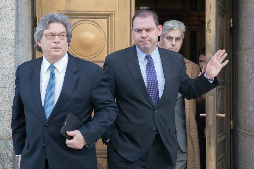 Joseph Percoco, center, leaves Federal court with his attorneys Barry Bohrer, left, and Michael Yaeger, Thursday, Dec. 1, 2016, in New York. The U.S. Attorney?s office in Manhattan has filed a response in federal court challenging accusations from a former top aide to Gov. Andrew Cuomo that the prosecution withheld key evidence in the aide?s upcoming corruption trial. (AP Photo/Mary Altaffer)