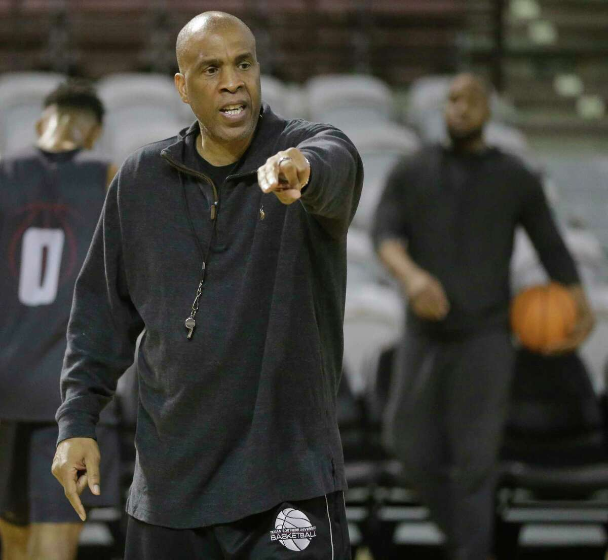 TSU coach Mike Davis runs his players through the paces at practice Wednesday in preparation for a non-conference road schedule that starts Friday at Gonzaga and ends Dec. 23 at BYU.