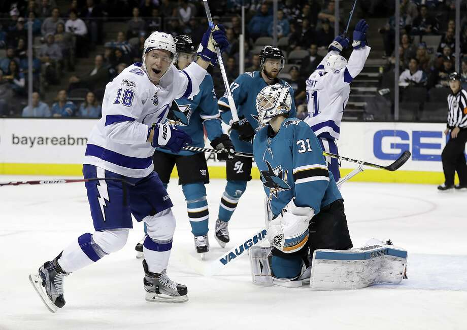 Tampa Bay Lightning wing Ondrej Palat (18) celebrates a goal by Jake Dotchin (not seen) past Sharks goalie Martin Jones during the first period of their game at SAP Center. Jones was lifted after two periods, having allowed four goals. Photo: Marcio Jose Sanchez, Associated Press